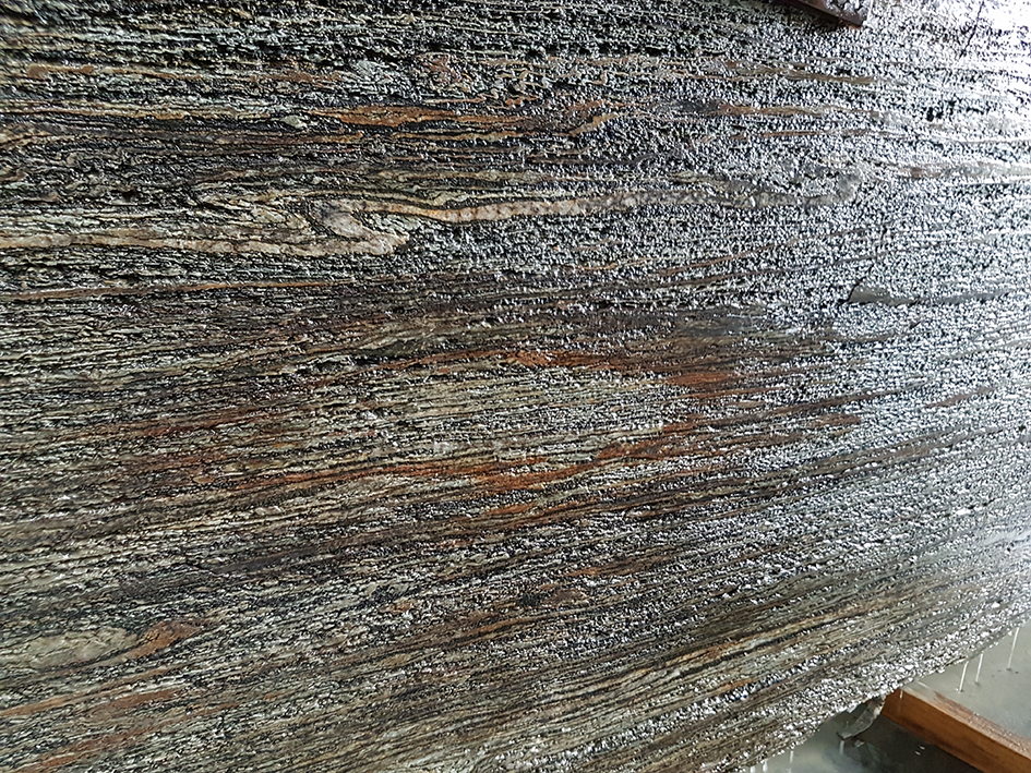 New Zealand Stone Products: Water worn wet slab File name: